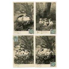 Babies in a Nest Series of Four Antique French Real Photo Postcards 1904