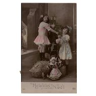 Edwardian Girls and Toys Antique French real Photo Christmas Postcard