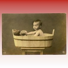 Baby in Wooden Tub with Teddy Bear Antique Real Photo Postcard