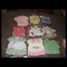 MIP Assortment of Nine Older Doll Clothes