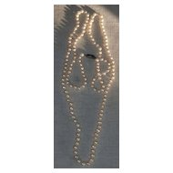 Long Slinky Freshwater pearl with antique silver clasp