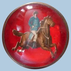 Victorian Die-Cut Gentleman Rider on Horse Bridle Rosette Pin on Intense Crimson Red Background