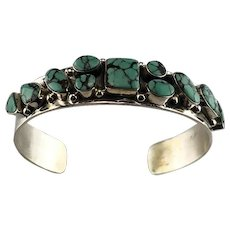 Navajo Sterling and 11 Stone Turquoise Bracelet