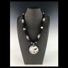 White Fox Creation: White Buffalo, Onyx and Howlite Necklace