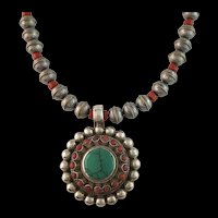 White Fox Creation: Old Turquoise and Coral Pendant on Stamped Sterling Beads.