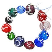 Set of 12 Hollow Glass Beads from Our Hot Glass Studio And One Freebie