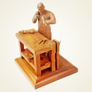Carving of Cabinetmaker at Work Bench, Signed