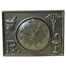 Working Vintage Brass Electric Pharmacy Clock with Apothecary Symbols, Ca. 1940-50's