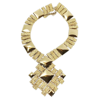 """MONET Large Bright and Textured Gold Tone Metal Massive """"V"""" Necklace with Abstract Modernist Drop Pendant"""