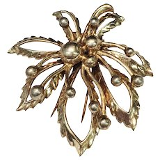 NETTIE ROSENSTEIN 1940s Gold Wash Skeletal Flower with Buds Clip Brooch Sterling with Gold Wash