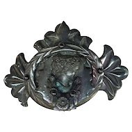 Highly Detailed Gutta Percha Framed Cameo with Leaf Edging and Bale