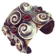 DARREN MANES Ruby Red Glass Rhinestone and Antiqued Brass Metal Swirl Wide Modernist Cuff Bracelet