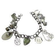 Vintage Sterling Silver  Charm Bracelet  Moving Charms Some Older 13 Charms SALE