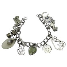 Vintage Sterling Silver  Charm Bracelet  Moving Charms Some Older 13 Charms