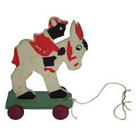 1930's Donkey & Rider Bumpa Pull Toy