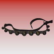 "11 Primitive Brass Sleigh Bells On 64"" Leather Belt"