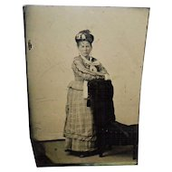 Tintype Of a Woman Resting Arms On The Back Of a Chair