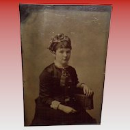 Antique Tintype Of a Young Woman Sitting On a One Arm Chair