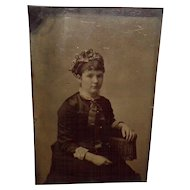 Tintype Of a Young Woman Sitting On a One Arm Chair