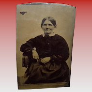 Antique Tintype Of a Woman Sitting On a One Arm Chair