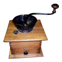 Primitive Coffee Grinder with Cup Loading Top