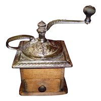 Antique Coffee Grinder with Ornate Top and Dovetail Design