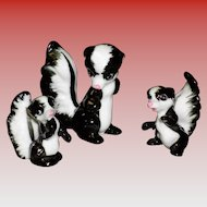 Set of 3 Porcelain Skunks Figurines