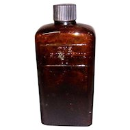 The J. R. Watkins Co. Amber Brown Bottle with Cap