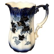 Antique Porcelain Flow Blue & Gold Trim Pitcher