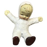 Vintage Snow Baby Figurine in Snow Suit Sitting Down