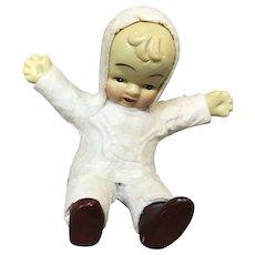 Vintage Snow Baby Figurine in Snow Suit Sitting Down