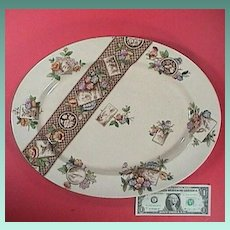 1884 Brown Printed Aesthetic Platter with colorful hand painted accents by Adderley pottery