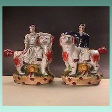 Pair of King Charles Mantle Spaniels with Sitting Youths (20th C vintage Figurines)
