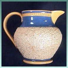 c1820 British Chipped Clay Banded Early Yellowware Miniature Pitcher with Rouletted Beading (2 7/8 in. tall)