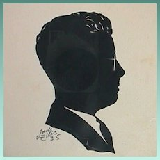 Framed Cut Paper Silhouette of Man in Suit Coat with Wire Rim Spectacles (dated 1935, signed Jack Ellis)