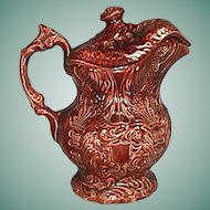 c1830 Brown Treacle Glazed Pottery Covered Pitcher with Ornate Molded Lacework, Fish Scales, Scrolls, etc.