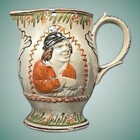 c1795 Pearlware Pitcher with Relief Molded Rendering of the Miser Painted in Pratt-style Colors