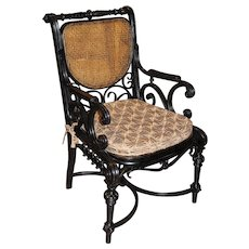 Aesthetic Period Ebonized Bentwood Armchair with Caned Seat and Back