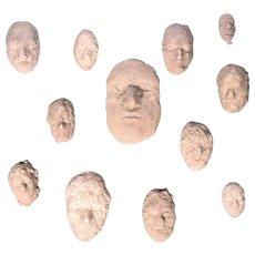 Neal Beckerman Set of 12 Abstract Plaster Relief Sculptures, Heads