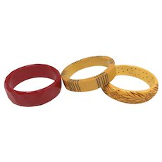(3) Assorted Womens Red & Gold/Yellow Bakelite Bracelets