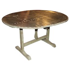 19th Century French Zinc Tilt Top Wooden Oval Wine Table with Shoe Feet