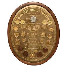 Oval Award Plaque of Grand Prix Medals for Maison Paul Raguet, Paris to Cairo 1900-1929
