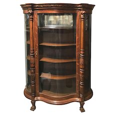 Early 20th Century Oak Serpentine China or Display Cabinet with Foliate Carving
