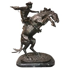 After Frederic Remington, Cast Bronze Sculpture of A Cowboy on Horse, Bronco Buster