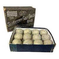 12 Antique English Gutta Percha Golf Balls in Silvertown Box circa 1900