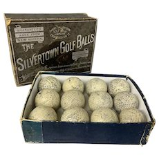 12 Antique English Gutta Percha Golf Balls in Silvertown Box circa 1900