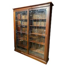 Grand Scale Mahogany Custom Bookcase with Leaded Glass Sliding Doors