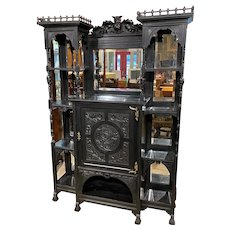 Ebonized Étagère Cabinet with Owl Crest Attributed to Bancroft & Dyer circa 1885
