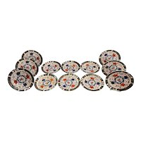 Set of 12 English Royal Crown Derby Dinner Plates in the Imari Palette