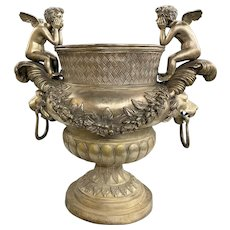 Silvered Metal Handled Garden Urn with Lion Heads and Winged Putti